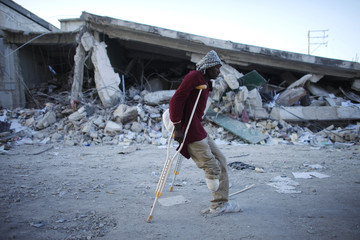 A disabled man who was a victim of the earthquake walks with the help of crutches in Port-au-Prince