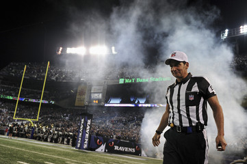NFL referee Gene Steratore walks onto the field before the Cleveland Browns play the Baltimore Ravens