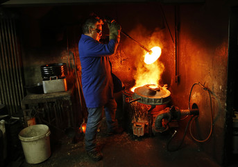 Huguenin of the Blondeau foundry removes the cover of the oven during the preparation of the bronze bells in La Chaux-de-Fonds