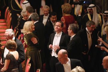 Britain's Prime Minister David Cameron arrives for a State Banquet for the Emir of Kuwait, Sheikh Sabah al-Ahmad al-Sabah at Windsor Castle, in Windsor