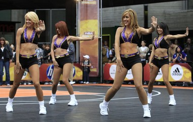 Members of the 'Laker Girls' perform during an event for basketball fans, in London