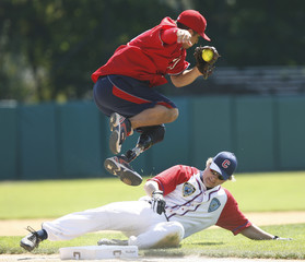 Wounded Warrior Amputee Softball Team third baseman Saul Bosquez leaps in Cooperstown