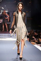 A model presents a creation by French designer Jean Paul Gaultier as part of his Spring/Summer 2014 women's ready-to-wear fashion show during Paris fashion week