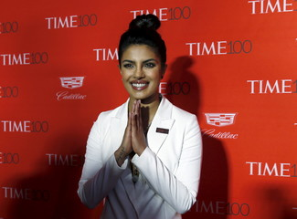 Actress Priyanka Chopra poses for photographers on the red carpet as she arrives for the TIME 100 Gala in Manhattan, New York, April 26, 2016.