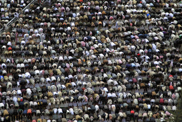 Anti-government protesters perform weekly Friday prayers during a rally to demand the trial of Yemen's President Ali Abdullah Saleh in Sanaa