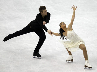 Ilinykh and Katsalapov of Russia perform during the ice dance free dance at the ISU World Figure Skating Championships in Nice