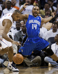 Magic's Nelson loses possession against Bobcats' Diaw during first half of NBA playoffs game in Charlotte