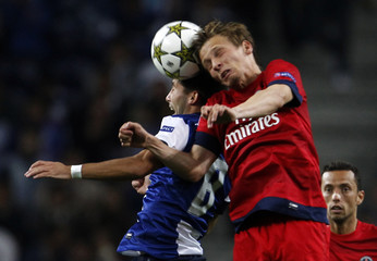 Porto's Moutinho jumps for ball with Paris Saint Germain's Chantome during Champions League Group A soccer match in Porto