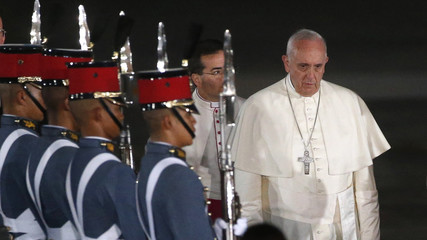 Pope Francis walks past cadets from the Philippine Military Academy upon arrival at Villamor Air Base for a state and pastoral visit, in Manila