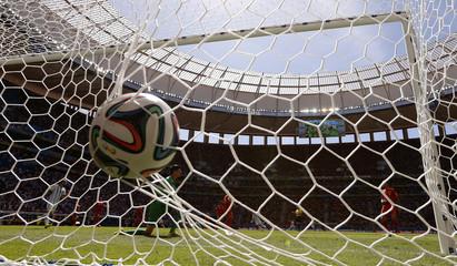 Argentina's Higuain scores past  Belgium's Courtois during 014 World Cup quarter-final in Brasilia