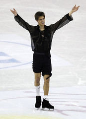 Pfeifer of Austria performs with his pants rolled up after experiencing a problem with the laces of his skates during the men's short program at the ISU World Figure Skating Championships in Nice