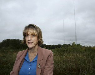 Former Loudoun County Commissioner Kelly Burk is pictured near three towers that broadcast Beijing radio  in Ashburn Virginia