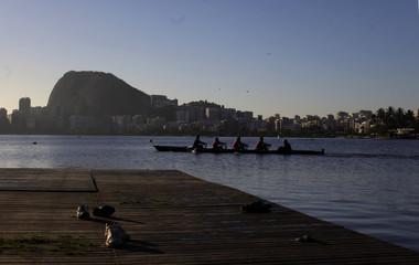 Men row a skull on Rodrigo de Freitas Lagoon in Rio de Janeiro