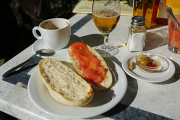 spanish lunch- coffee, beer, olives and toast with tomatoes and olive oil