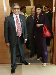Pakistan's FM Khar leaves for tea break with India's FM Krishna during the SAARC countries foreign ministers meeting in Addu