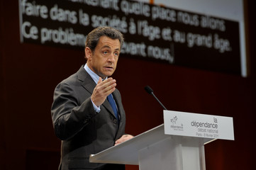 France's President Nicolas Sarkozy delivers a speech at the closing of a meeting on national debate on dependent people