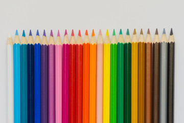 Colour pencils over white background. Shallow depth of field.