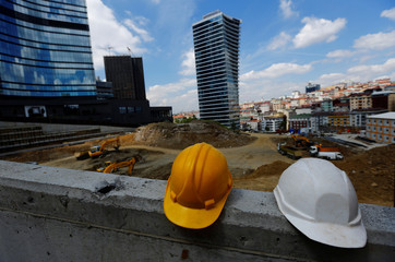 Safety helmets are seen at the construction site of a new office building in Istanbul's business district of Sisli