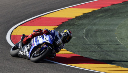 Yamaha MotoGP rider Jorge Lorenzo of Spain takes a curve during the first free practice at the Aragon Grand Prix at Motorland race track in Alcaniz, near Zaragoza