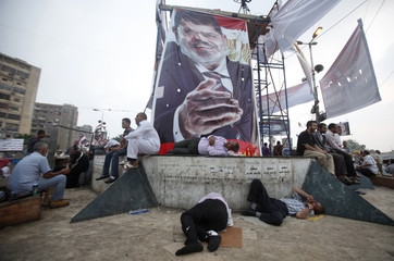 Supporters of deposed Egyptian President Mohamed Mursi sleep at the Rabaa Adawiya square where they are camping in Cairo