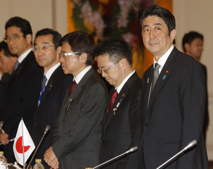 Japan's Prime Minister Abe attends a meeting with Thailand's Prime Minister Yingluck during his visit to Thailand at the Government House in Bangkok