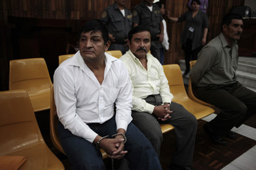 Martinez Hernandez, Collin Gualip and Pop wait for their sentence during a hearing at the Supreme Court in Guatemala City