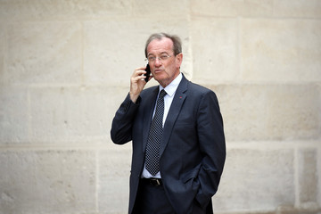 Michel Gaudin, former Paris Police Prefect, talks on his mobile phone after the funeral of late former French right-wing politician Charles Pasqua at the Invalides in Paris