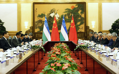 Uzbekistan's President Islam Karimov meets with his Chinese counterpart Xi Jinping at the Great Hall of the People in Beijing