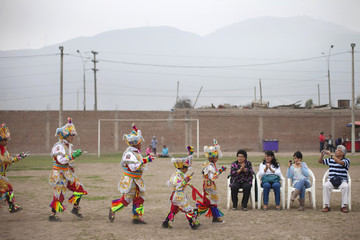 """""""Scissors"""" dancers walk in a line before performing in a national scissors dance competition in the outskirts of Lima"""