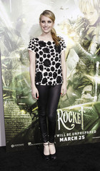 """Roberts poses at the premiere of """"Sucker Punch"""" at the Grauman's Chinese theatre in Hollywood"""