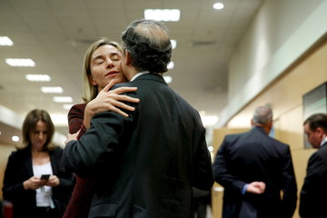 Mogherini is greeted by a member of the U.S. delegation as she arrive to meet with Kerry alongside NATO ministerial meetings at NATO Headquarters in Brussels