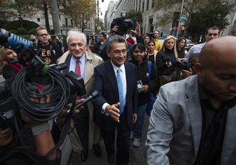 Rajat Gupta departs Manhattan Federal Court with his lawyer, Gary Naftalis after being sentenced in New York