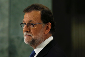 Spain's acting PM Rajoy listens to a question during a news conference at the parliament in Madrid