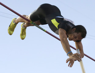 France's Lavillenie competes in the men's pole vault during the Athletissima Diamond League meeting in Lausanne