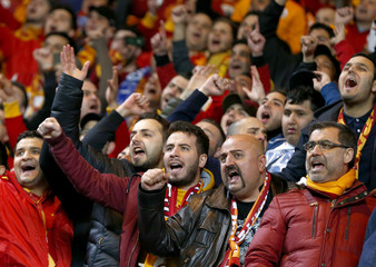 Galatasaray fans chant before their Champions League soccer match against Chelsea at Stamford Bridge in London