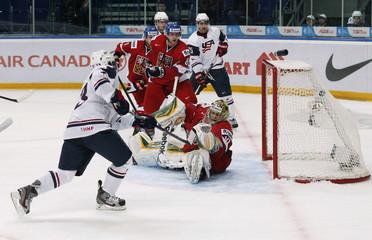 Team USA's Gaudreau scores goal on Czech Republic's goalie Machovsky during their quarter-final game in Ufa