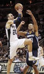 San Antonio Spurs' Ginobili goes to the basket against Memphis Grizzlies' Battier during their NBA basketball playoffs in San Antonio