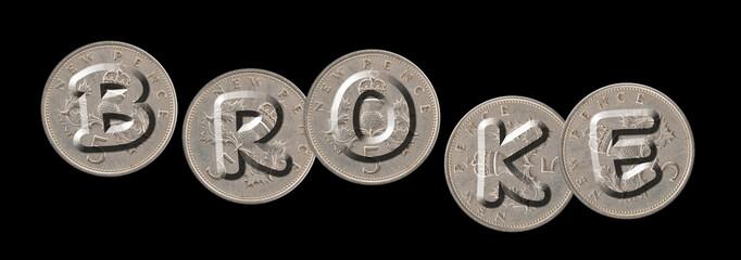 BROKE – Coins on black background