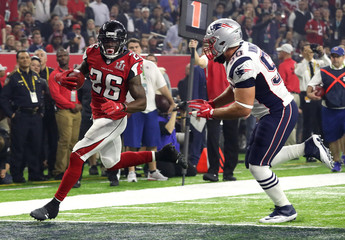 Atlanta Falcons' Coleman runs into the end zone to score past New England Patriots' Ninkovich during the third quarter of Super Bowl LI in Houston