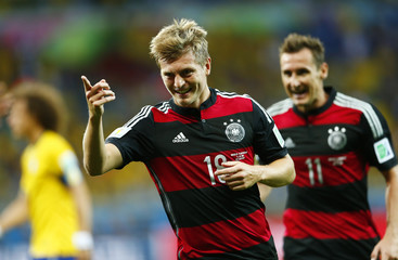 Germany's Kroos celebrates his second goal, his team's fourth, against Brazil during their 2014 World Cup semi-finals at the Mineirao stadium in Belo Horizonte