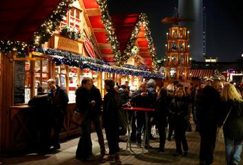 People visit the Christmas market near Alexanderplatz square in Berlin