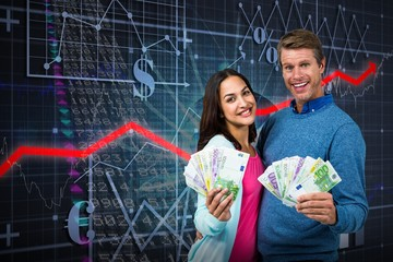 Composite image of portrait of couple showing money