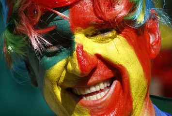 A fan waits for the 2014 World Cup Group B soccer match between Australia and Spain at the Baixada arena