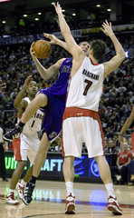 Sacramento Kings Andres Nocioni drives to the basket past Toronto Raptors Andrea Bargnani in Toronto.