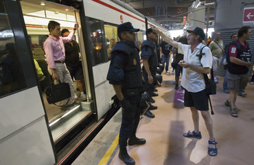 A rail worker argues with passengers during a strike at Atocha station in Madrid