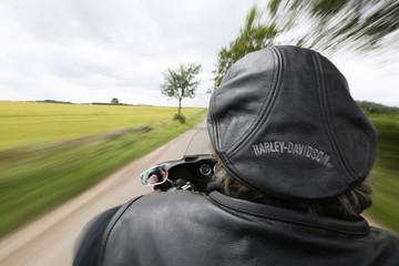 Harley Davidson enthusiast Wolfie rides through the Angus countryside, Scotland