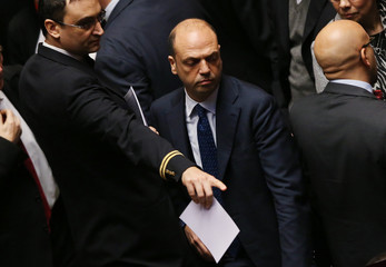An assistant points next to Italy's Interior Minister Angelino Alfano, during the election of Italy's new President Sergio Mattarella, in the lower house of the parliament in Rome
