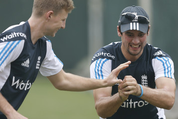 England's captain Alastair Cook and his teammate Joe Root attend at a physical training session during a practice session in Colombo