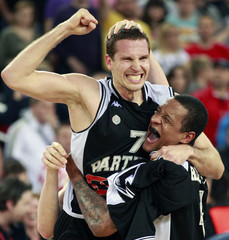 Kecman and Roberts of Partizan Belgrade celebrate after defeating Cibona Zagreb in the Final Four final in Zagreb