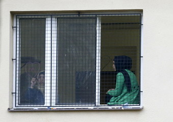 A migrant draws a heart on a window in the Facility For Detention Of Foreigners in Bela-Jezova